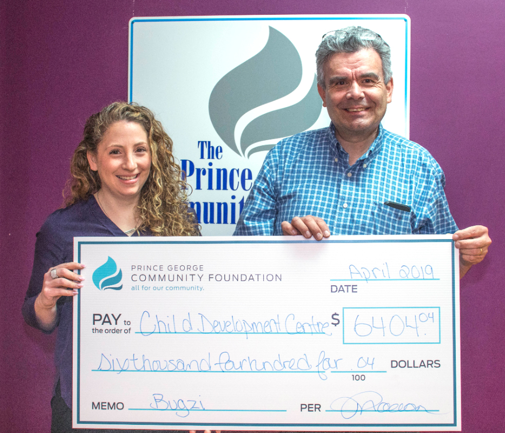 Mindy Stroet, senior fund development officer with the Prince George Community Foundation Child Development Centreexecutive director Darrell Roze with a cheque for $6,404.04. The funds are from the Miracle Theatre raffle and will go towards the purchase of a Bugzi wheelchair. The Bugzi offers a unique opportunity for pre-school children with disabilities to experience independent mobility, often for the first time in their lives. The Bugzi is an ideal training chair to help children to learn how to move, how to activate switches to impact their lives, and provide some independence in the classroom or at home. With its bright colours children are attracted to the chair so they want to drive, and the ability to drive it with a variety of switches or controls allows adults to use the Bugzi to train many children with different needs. The Prince George Community Foundation and Miracle Theatre are thrilled to be able to provide this support to the Child Development Centre.