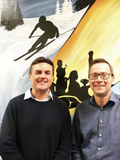 David O'Connor, a principal from Australia, left, poses in front of a mural in Westwood Elementary School's front entrance with Westwood principal Steve Dalla Lana. School District 57 photo