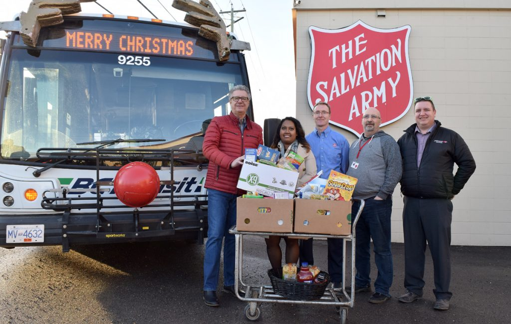 """Food for Fare, where residents could ride BC Transit for free with a non-perishable food item for the Salvation Army, was held Dec. 12-14. Delivering the goods today are Mayor Lyn Hall (left); Champa Maduranayagam, city transit planner; Roy Law, community ministry director for the Salvation Army; Bill Glasgow of the Salvation Army; and Dave Wilson, operations manager PG Transit. """"The more food we can give out to the community in need is useful,"""" said Law. He said items with higher proteins, such as canned meats, nuts, and peanut butter are in high demand. Bill Phillips photo"""
