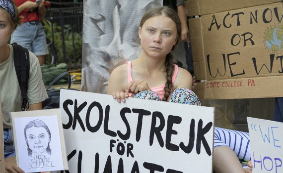 The Swedish teenage climate activist, Greta Thunberg (centre), joins other young people for a school strike or demonstration outside the United Nations in New York on 30 August 2019. UN Photo/Manuel Elias