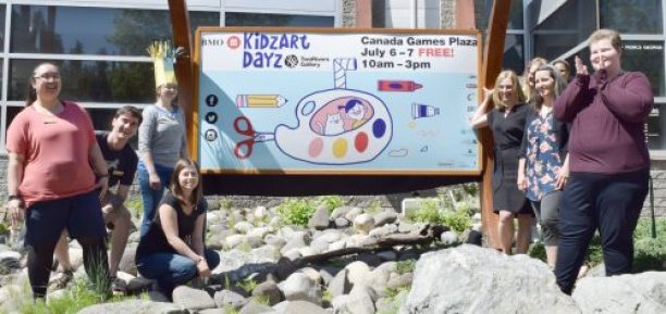 Two Rivers Gallery staff unveil the artwork of Jenny Hsieh that will be featured in promotional material for BMO KidzArt Dayz. Bill Phillips photo
