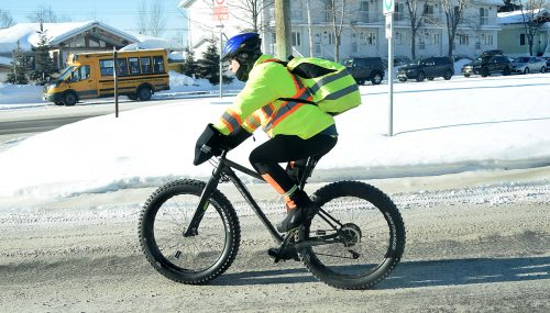 Icy roads and -10 degrees Celsius? No problem as long as you are dressed property and have your snow tires on. This cyclist was making his way along Third Avenue Thursday morning, probably on his way to work. Bill Phillips photo