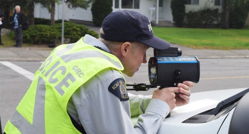 Checking for speeders near College Heights Elementary School. Bill Phillips photo