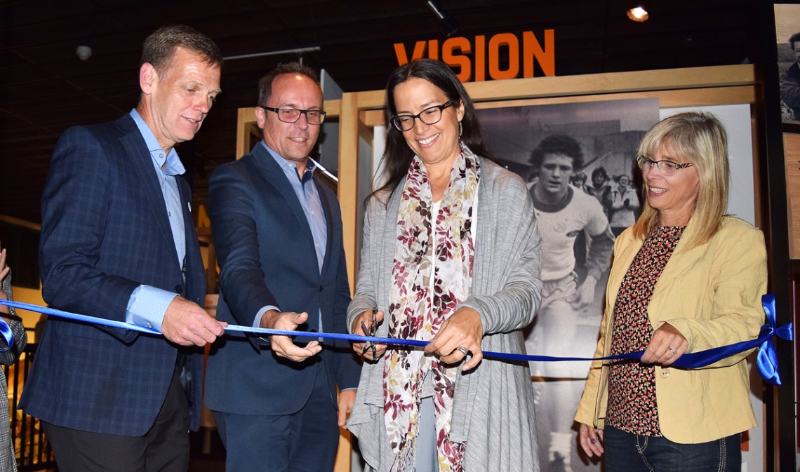 Dr. Nadine Caron cuts the ribbon to officially open the Terry Fox exhibit at The Exploration Place. Helping out are Terry's brother Darrell (left), Jean-Marc Blais from the Canadian Museum of History, and Kathie Scouten. Bill Phillips photo