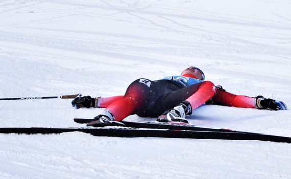 Norway's Vilde Nilsen takes a much deserved break after crossing the finish line in the Women's Sprint Standing race during the 2019 World Para Nordic Skiing Championships Wednesday. Bill Phillips photo