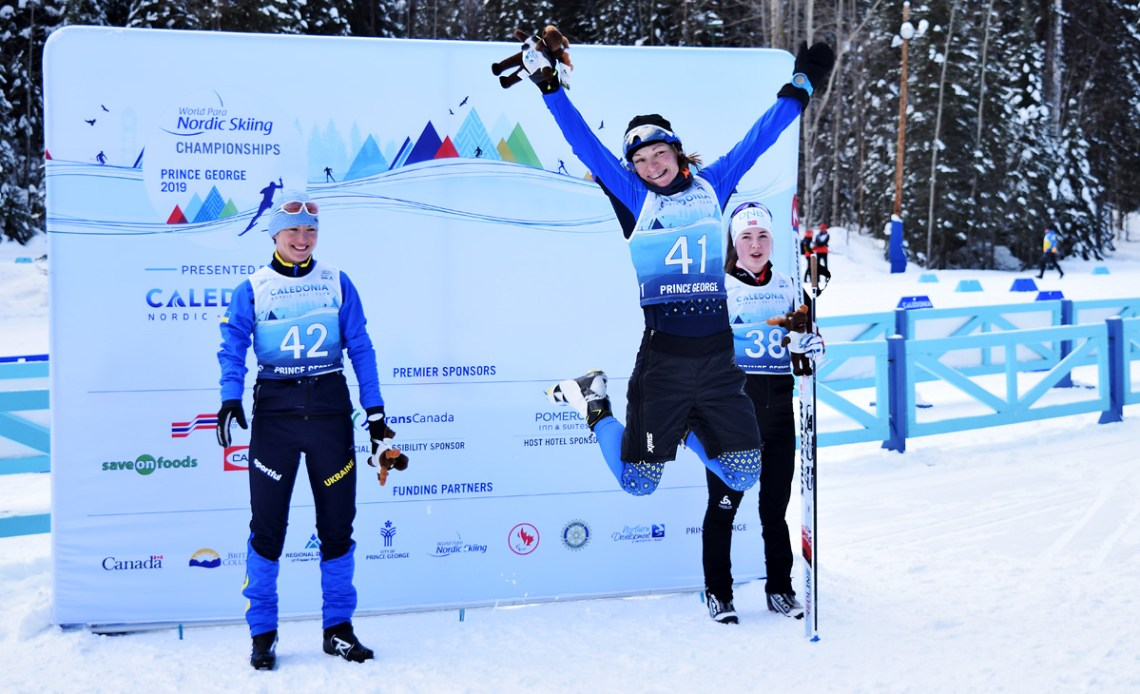 Ukraine's Liudmyla Liashenko jumps for joy after winning the gold medal in the Women's Sprint Standing race at the 2019 World Para Nordic Championships Wednesday. Vilde Nilsen (right) of Norway won the silver and Oleksandra Kononova of the Ukraine the bronze. Bill Phillips photo