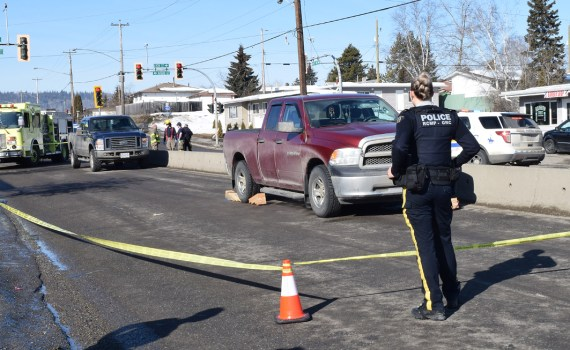 Police and emergency crews attend the scene on Fifth Avenue at Spruceland where a pedestrian was hit by a vehicle Sunday morning. The pedestrian was taken to hospital and their condition is not known at this time. Bill Phillips photo