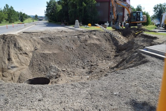 City crews are working on determining the cause of the sinkhole that opened up at Winnipeg and Carney streets following this week's heavy rain. Crews will have to excavate down approximately 20 feet to look at a large drainage pipe installed the 1970s. Motorists are advised to avoid the area, if possible, as work will continue for at least the next few days. Bill Phillips photo