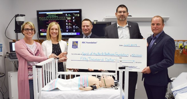 Spirit of the North Healthcare Foundation chair Colleen Sparrow, Tammy Hoefer, manager of simulation program, coordinator Michael Lundin, RBC VP Commercial Financial Services Sean Kehler, and local branch manager Tim Carmack with $50,000 for the Northern Clinical Simulation. Bill Phillips photo