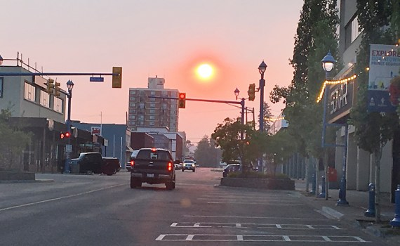 The sun made a dramatic exit Monday night, as witnessed looking west on Third Avenue. Bill Phillips photo