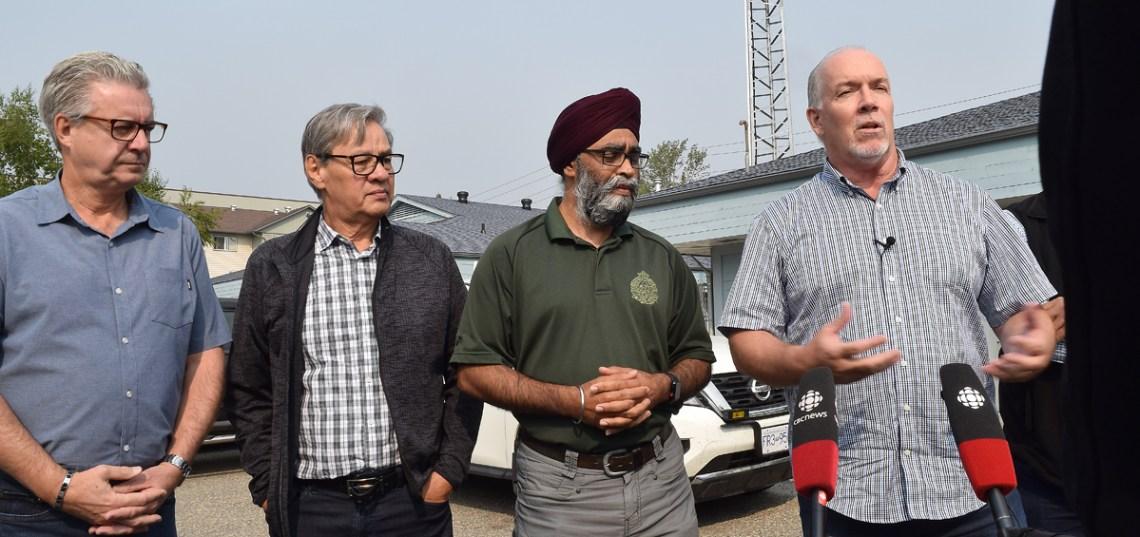 Premier John Horgan (right) speaks to media as Prince George Mayor Lyn Hall (left), Grand Chief Ed John, and Defence Minister Harjit Sajjan look on. Bill Phillips photo