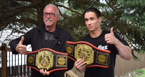 Jacob Lea and John Brink show off the Battle Zone belts Lea won recently in Alberta. Bill Phillips photo