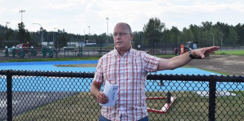 City parks supervisor Chris Bjorn explains some of the amenities at the refurbished Masich Place Stadium. Bill Phillips photo