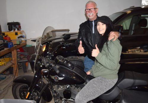 Harley Davidson enthusiast Amanda Espenhain meets fellow Harley rider John Brink and his bike. Bill Phillips photo