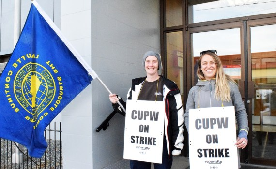 Canadian Union of Postal Workers members walk the picket line in front of the Canada Post office on Fifth Avenue Monday as rotating strikes hit the city. The strike action is for 24 hours. Bill Phillips photo