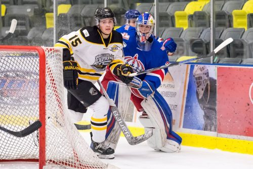 Spruce Kings goalie Bradley Cooper plays the puck behind the net in Sunday's 3-1 loss to the Express. Damon James Photography