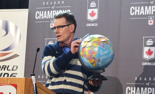 Glen Mikkelsen uses a globe to show where some of the competitors come from for the World Women's Curling Championships. Bill Phillips photo