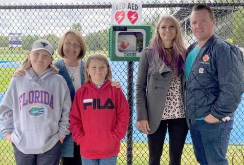 Bond donates portable defibrillators in memory of late husband