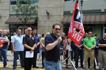 United Electrical, Radio & Machine Workers of America rally along North Shore Drive in front of the offices of the Pittsburgh Post-Gazette, Friday, June 7, 2019, to support the Newspaper Guild of Pittsburgh and other PG Unions. (Kurt Weber)