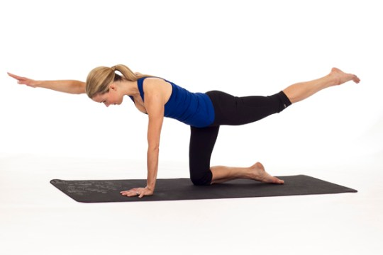 Bird Dog yoga pose that stregthens abs.