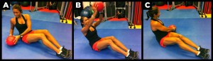 Woman work abs out with medicine ball.