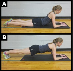 Woman exercising with the dolphin plank.
