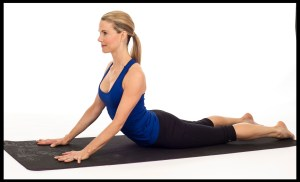 Woman practicing cobra pose.