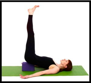 Woman doing shoulder stand exercise.