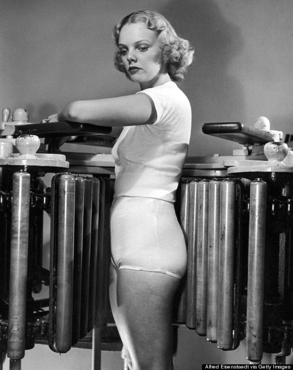 Model Pat Ogden at slenderizing salon using Wooden Barrel