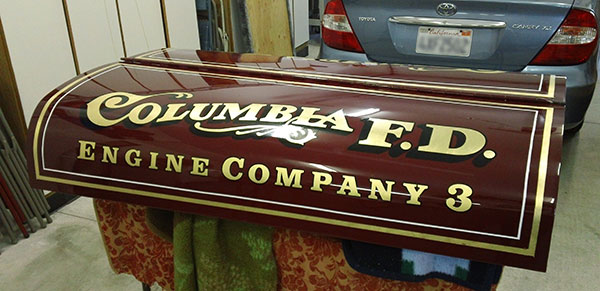 This vintage fire truck is being restored and I did the vehicle graphic for the cowling letters