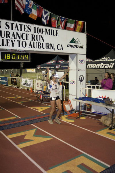 Image of Stephanie M. Howe, PhD, Endurance Runner & The North Face Athlete, at the finish line of a race.
