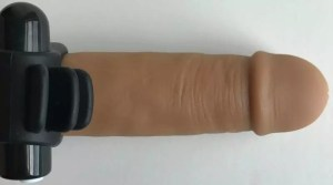Screaming O Charged Skooch vibrating cock ring fins on Tantus Alan