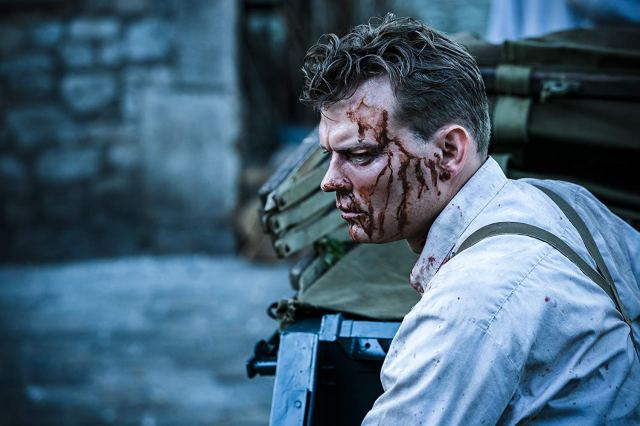 A bloody Captain Wafner collects himself during a battle scene in Overlord.