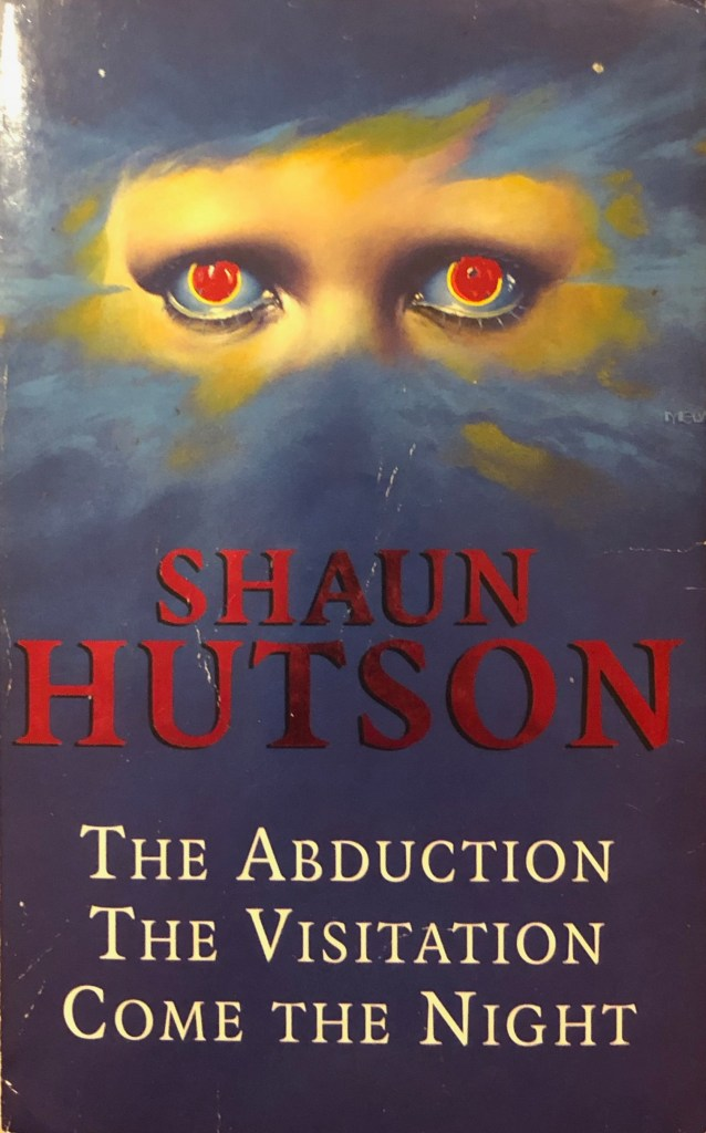 Front cover or Sean Hutson's collected works with an illustration of a pair of menacing red eyes surrounded by blue mist.