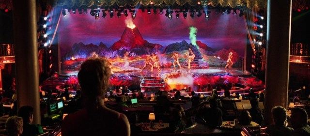 A classic Verhoeven wide shot of the Stardust stage as dancers perform the opening number of the Goddess review and Nomi looks on.