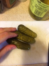 Pickles. Hand for scale.