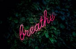 "Image of a sign that reads ""Breathe"""