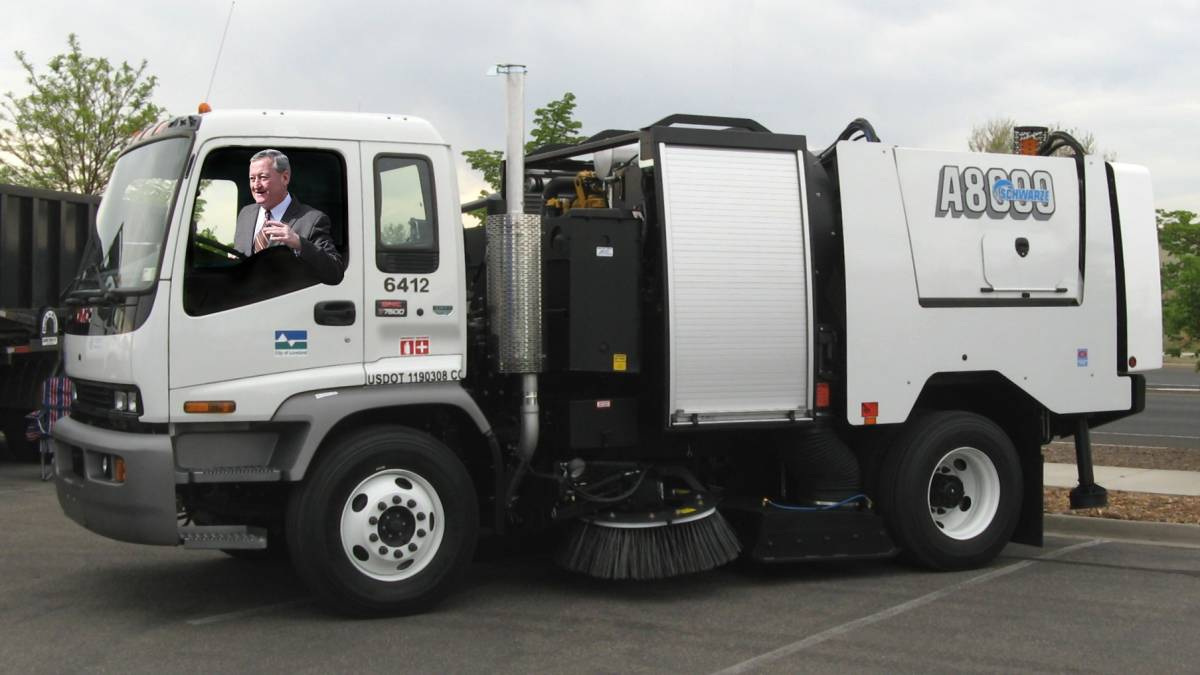 Jim Kenney in a street sweeper