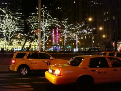 NYC yellow cabs at night - travel safety in many neighborhoods