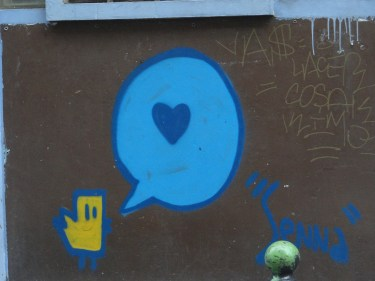 Paris street art - bird chiping love
