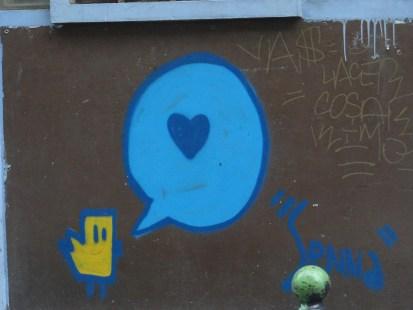 Paris street art - bird chiping love