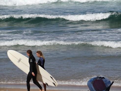 Surfers at Manly Beach Sydney Australia