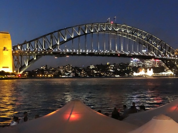 Sydney Harbour Bridge glows at night