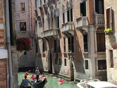 Venice canal view boats gondolas kayaks