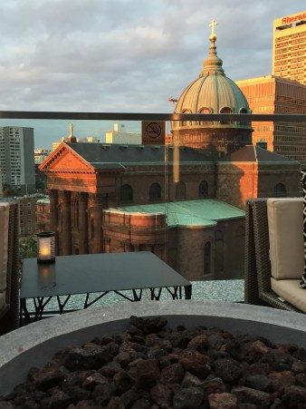 The logan hotel rooftop bar view of cathedral sunset