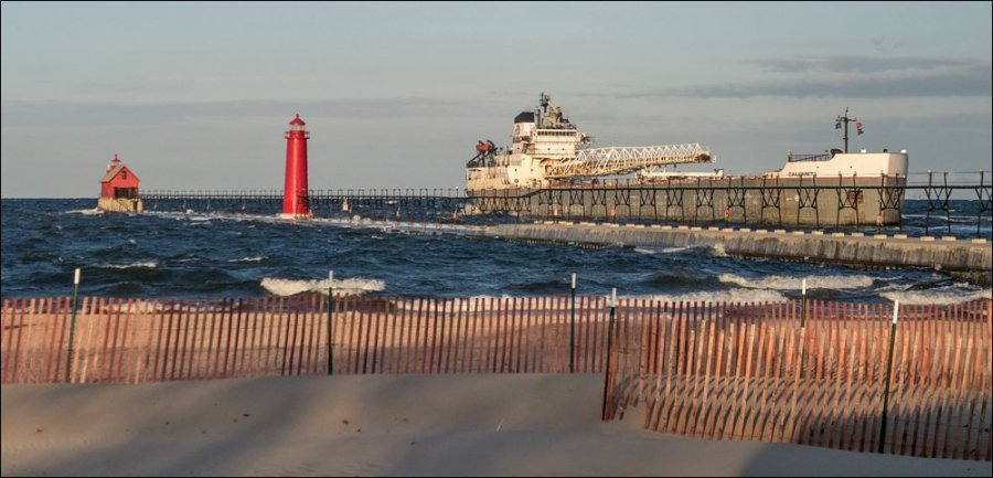 Canadian freighter Calumet backing out of Grand Haven channel