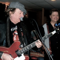 Playing blues harp with Rock 'n Roll Hall of Fame inductee Ricky Byrd (Joan Jett and the Blackhearts)