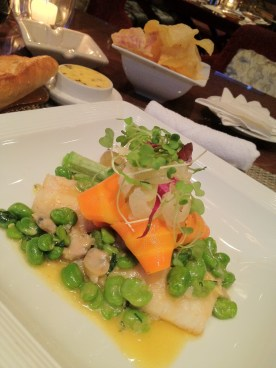 Oven-Baked Grouper in Clam Broth, Fava Beans, Carrot Flakes, Spring Onion-Fennel Salad
