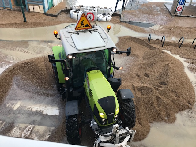 removing sand from the road