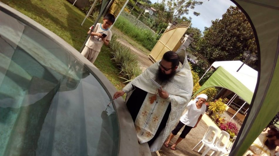 Father Philip blesses the water